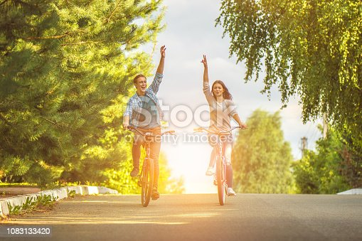 The happy couple cycling on the road