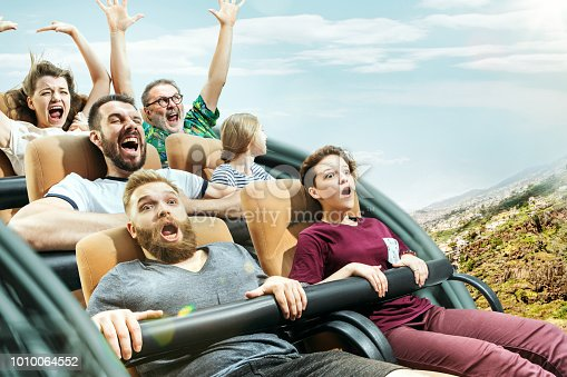 The happy emotions of men and women having good time on a roller coaster in the park. Human emotions concept. Collage