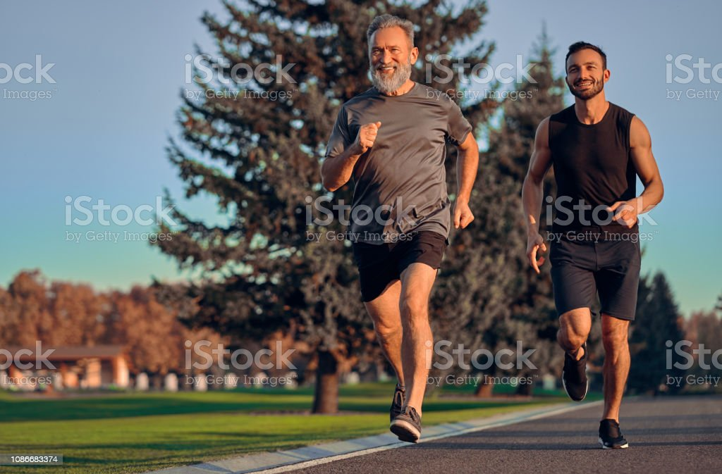 The happy father and son running on the road