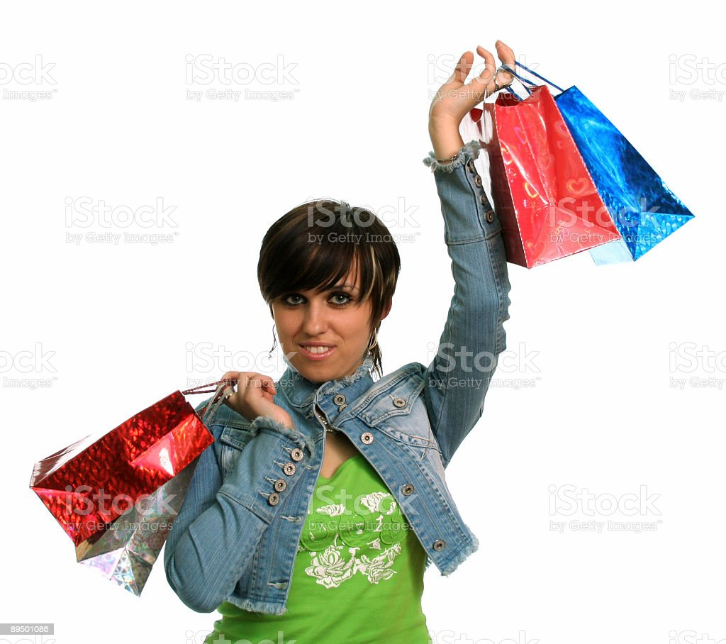 The happy girl with purchases royalty free stockfoto