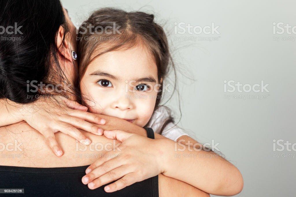 The Happy Little Girl Hugs Mom stock photo