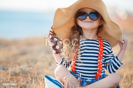 istock The happy little girl in a big hat 499875864