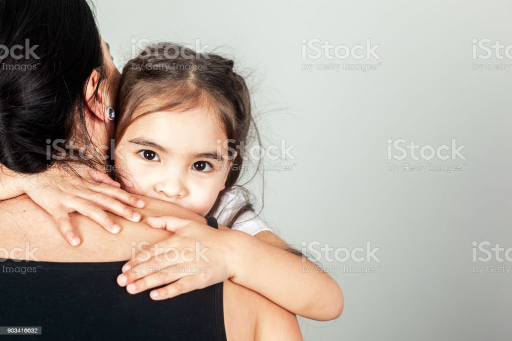 The Happy Small Girl Hugs Mom stock photo