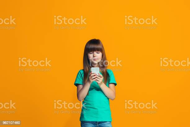 The happy teen girl standing and smiling against orange background picture id962107460?b=1&k=6&m=962107460&s=612x612&h=wfxs7mowb4x8nfehcbzxroddpjszkzazpx7huw9ujsw=