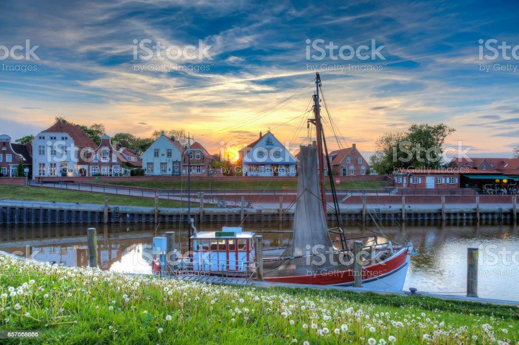 The harbor in Greetsiel at sunset. stock photo