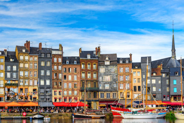 The harbor of Honfleur, Normandy, France with yachts The harbor of Honfleur, Normandy, France with yachts in sunny day calvados stock pictures, royalty-free photos & images