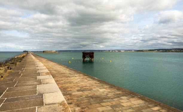 The harbour fortifications in the harbor of Cherbourg. Normandy, France Cherbourg-Octeville, France - August 27, 2018: The harbour fortifications in the harbor of Cherbourg. Normandy, France cherbourg stock pictures, royalty-free photos & images