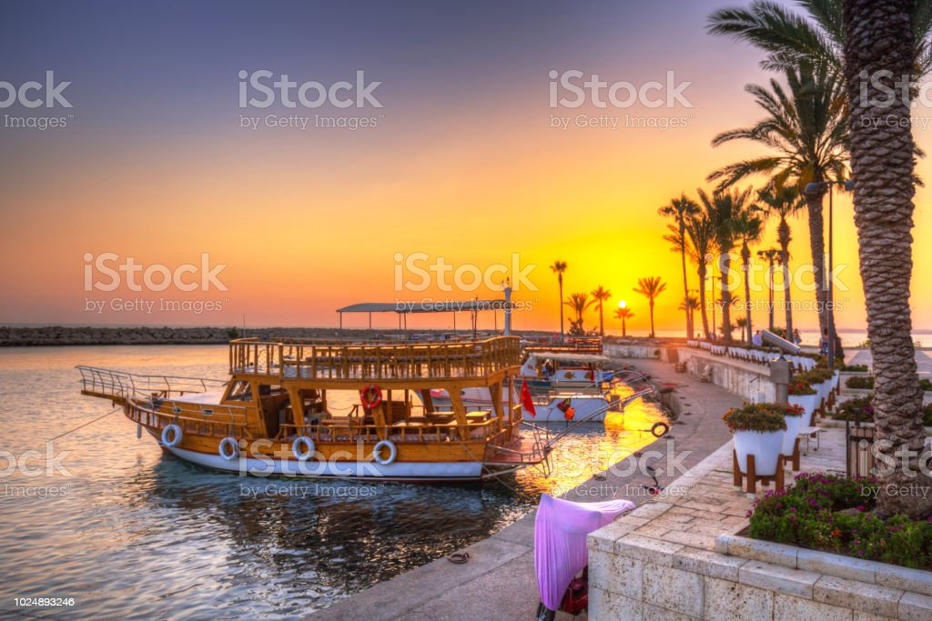 The harbour with boats in Side at sunset, Turkey stock photo