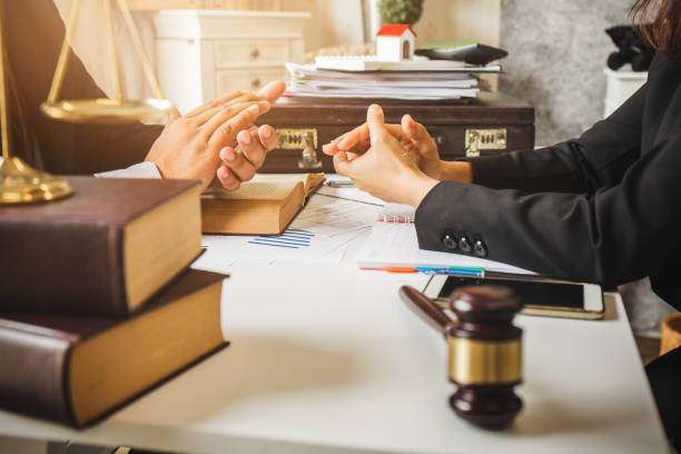 The hard work of an asian lawyer in a lawyer's office. Counseling and giving advice and prosecutions about the invasion of space between private and government officials to find a fair settlement. stock photo