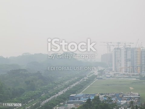 Yishun, Singapore - SEPTEMBER 18, 2019: The haze that enveloped Singapore for the past week hitanunhealthy levelon Wednesday(Sept 18) morning as workers headed to work and students to school.