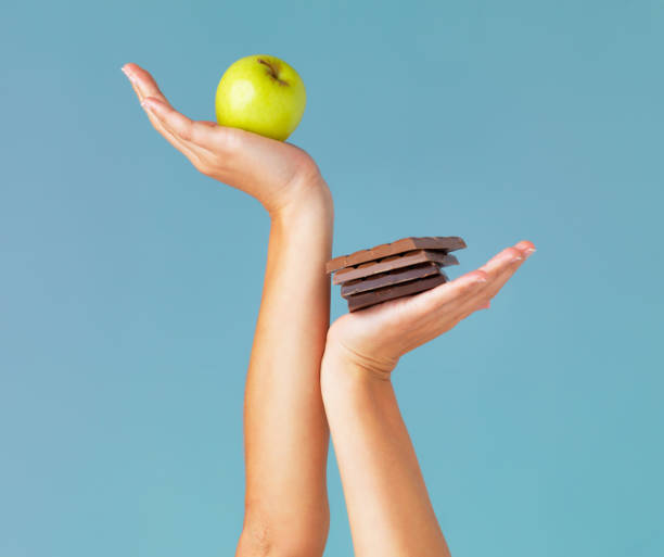 the healthy choice is in your hands - tentazione foto e immagini stock