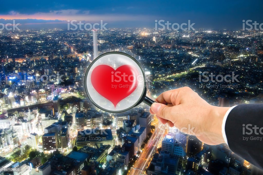 The heart in magnifying glass stock photo