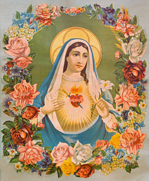 The Heart of Virgin Mary in the flowers. The Heart of Virgin Mary in the flowers. Typical traditional catholic image printed in Germany in end of 19. cent. originally designed by unknown painter and taken in village Sebechleby in Slovakia. religious saint stock pictures, royalty-free photos & images