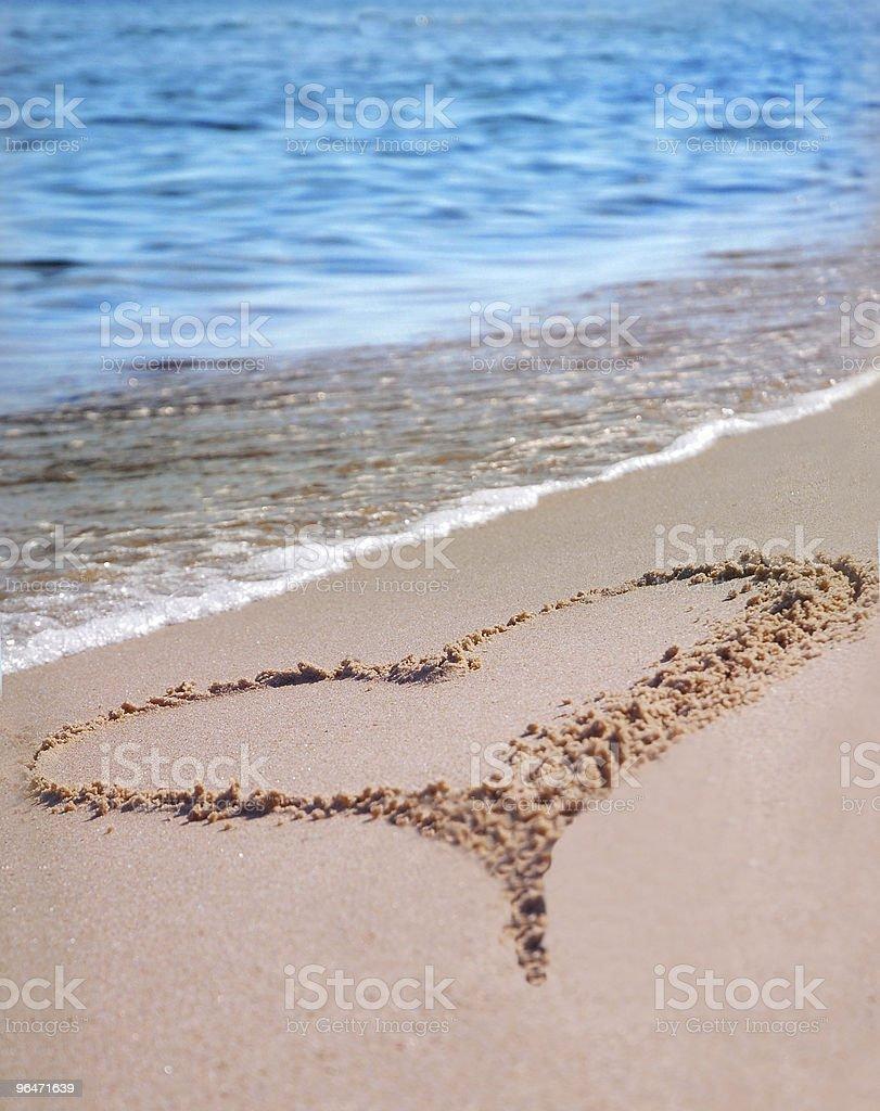 the heart on beach sand stock photo