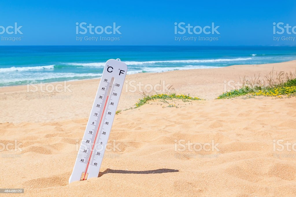 The heat on the beach. Thermometer for temperature weather. stock photo