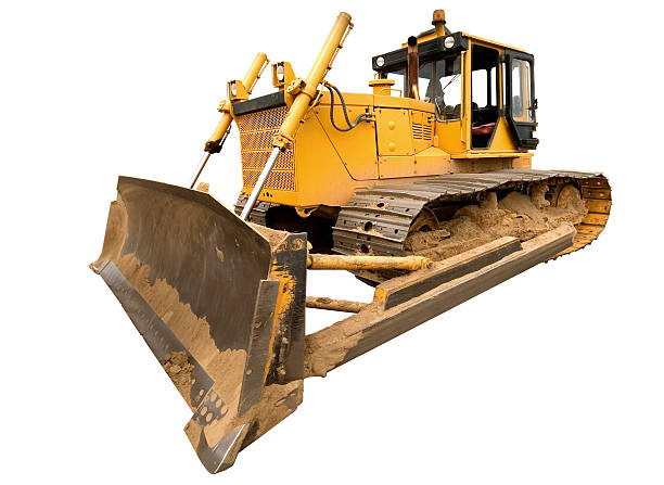 The heavy dirty building bulldozer of yellow color stock photo
