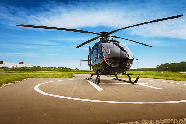 the helicopter in airfield - vliegveld stockfoto's en -beelden