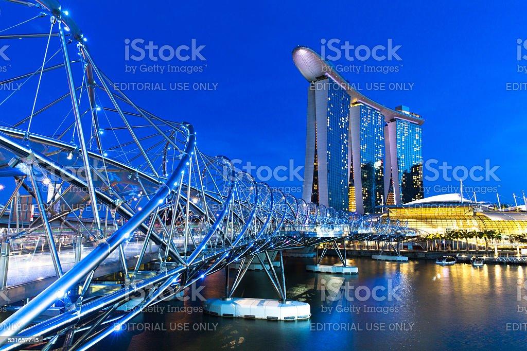 The Helix Bridge and Marina Bay Sands Hotel at night stock photo