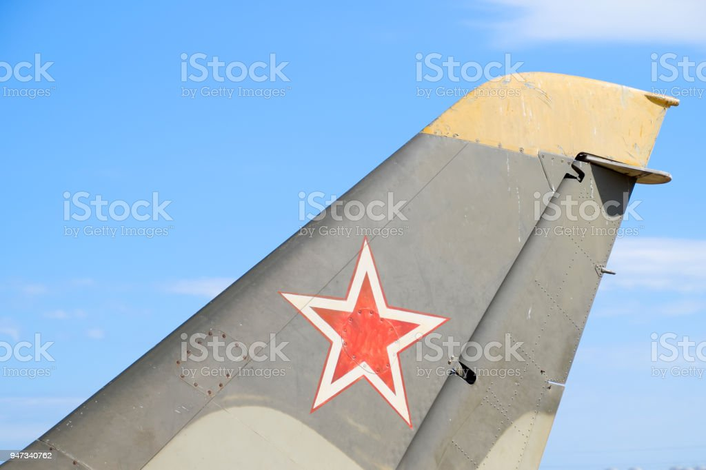 The helm of the fighter. Star on the tail of the plane. stock photo