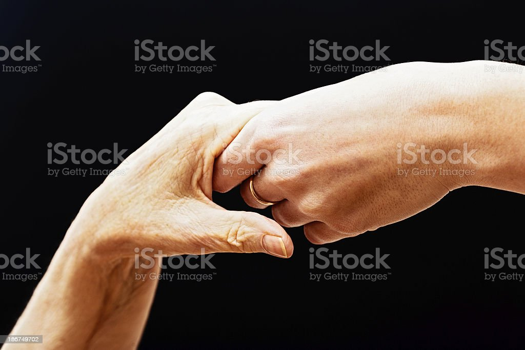 The helping hand: youth offers friendly assistance to aged royalty-free stock photo