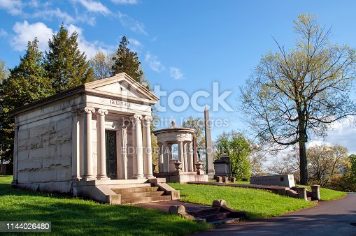Pittsburgh, Pennsylvania, USA 04/20/2019 The Hemphill and Baum family mausoleums next to a road in the Homewood Cemetery on a bright spring day