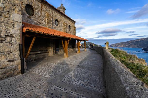 The hermitage of San Juan de Gaztelugatxe on the top of the islet, Bermeo, Basque Country, Spain stock photo