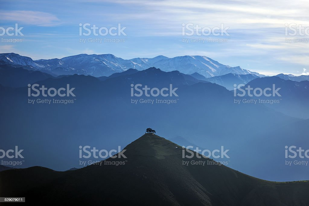 The High Atlas, valleys, hills mist, tree, Morocco, Africa stock photo