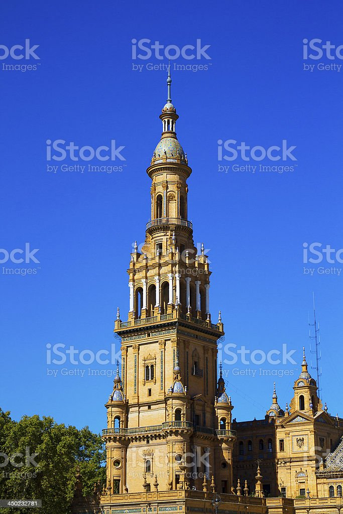 The high bell tower in Plaza de España, Seville, Spain. stock photo