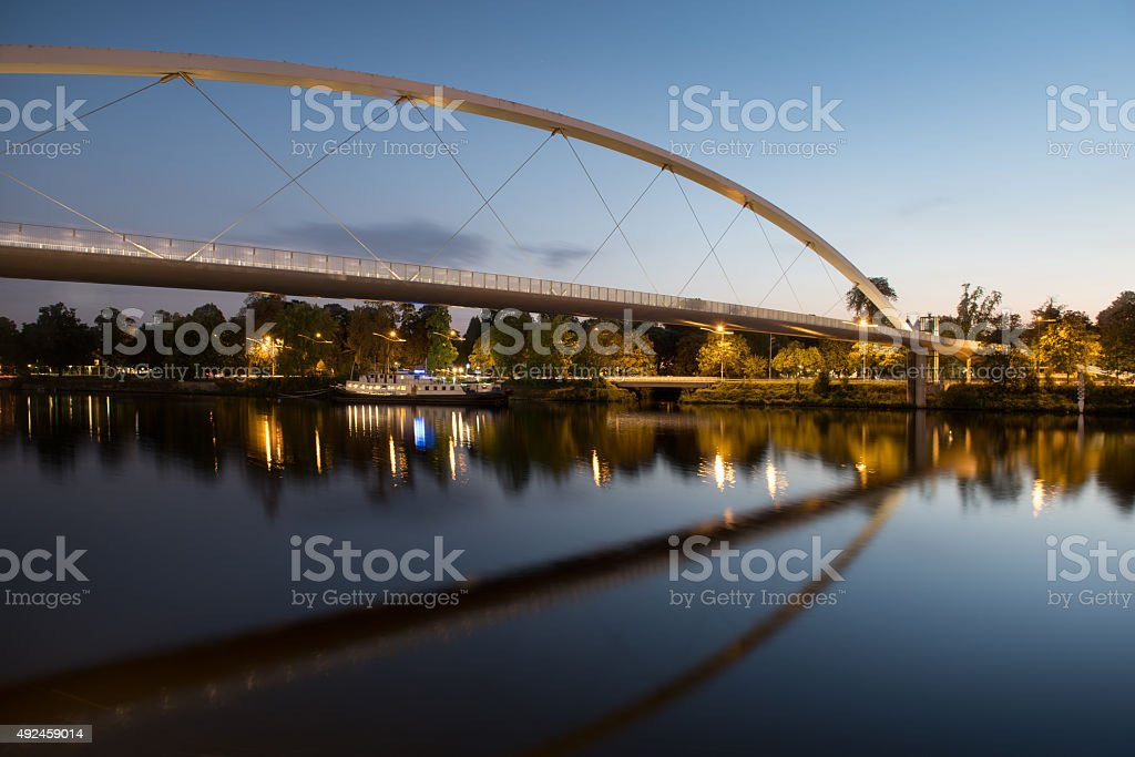 The High Bridge of Maastricht reflected in the Meuse river. stock photo