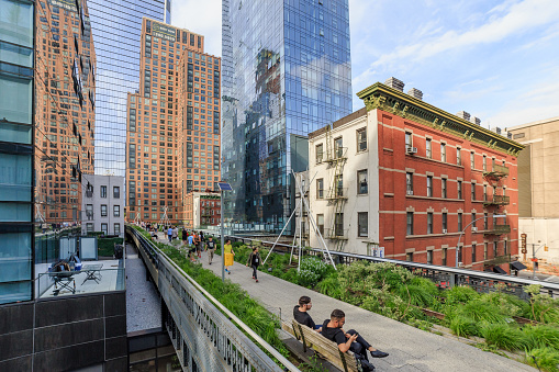 Manhattan New York, United States - May 20, 2018: The High Line is a public park built on an historic freight rail line elevated above the streets on Manhattan West Side. It is owned by the City of New York, and maintained and operated by Friends of the High Line.