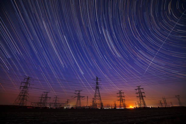 The high-voltage tower and the star track stock photo