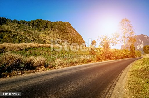 The highway in northen of laos, around grass field, bluesky, and sunrise