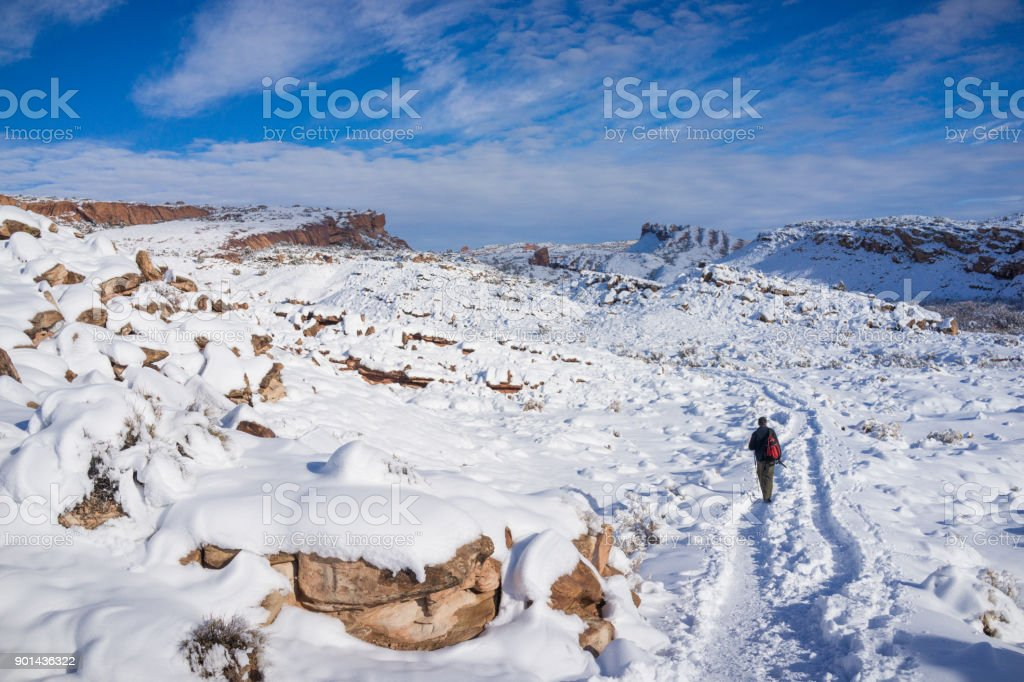 The Hiker Hiking at Arhces National Park in Snow in Winter stock photo