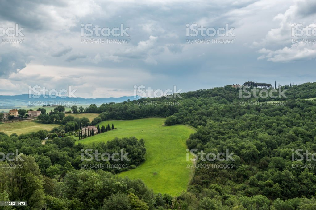 The hills of Val D'Orcia on a gloomy day stock photo