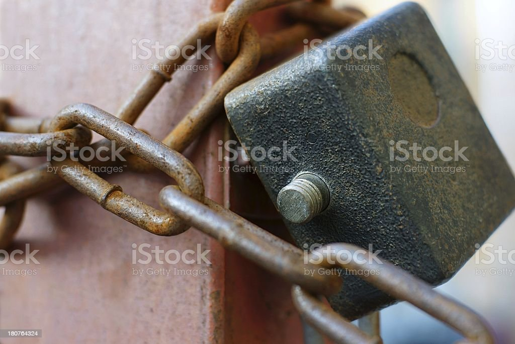 The hinged lock with a chain royalty-free stock photo