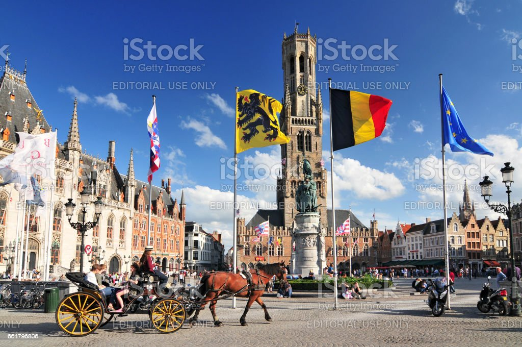 The historic belfry and city center square in the old medieval old town of Bruges (Brugge) Belgium. stock photo