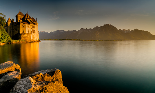 the historic Chillon Castle on the shores of Lake Geneva at sunset