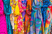 The Italian City of Verona on October 14, 2013: Vibrantly colored scarves offered in a public market stall found in the city of Verona, Italy
