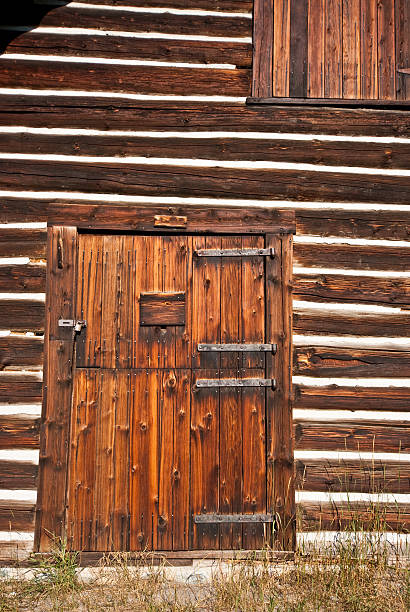 front door of historic lubec barn (1926) - st. mary lake stock pictures, royalty-free photos & images