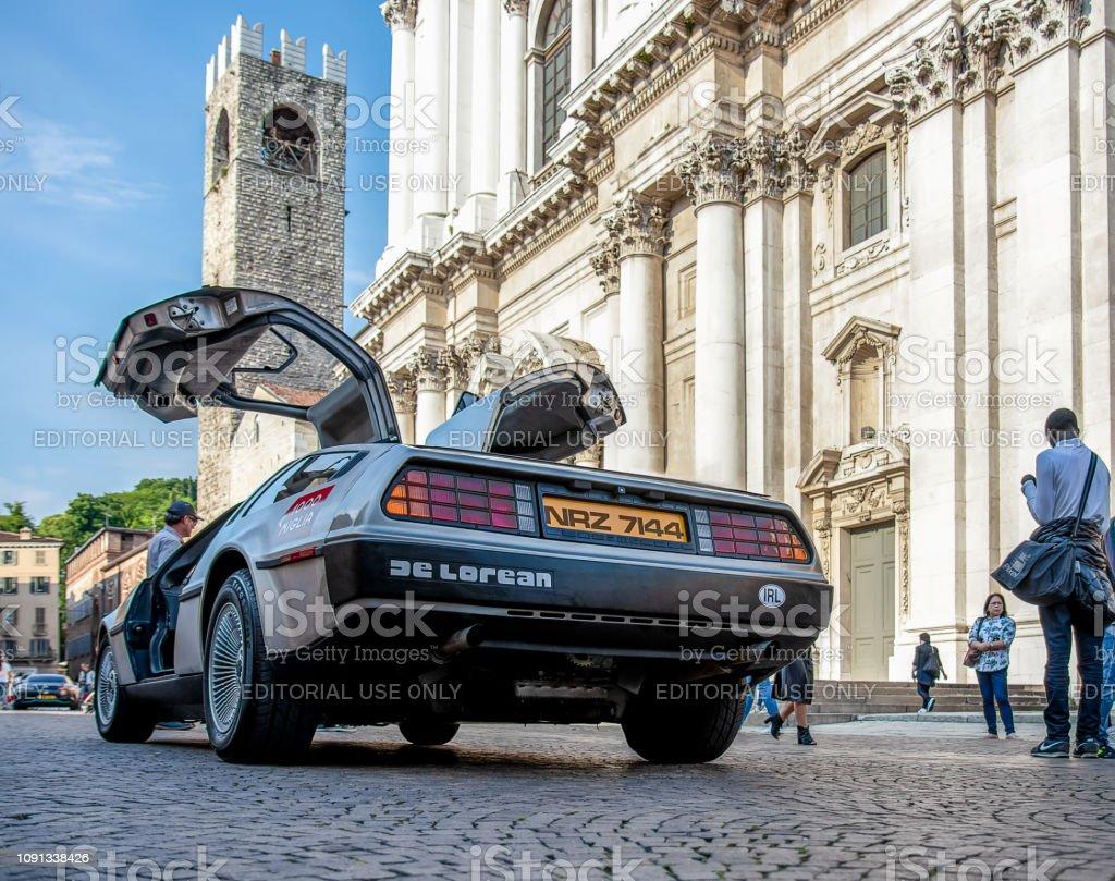 The historic Mille Miglia car race. The real DMC DeLorean 1981 on the Duomo square in Brescia stock photo