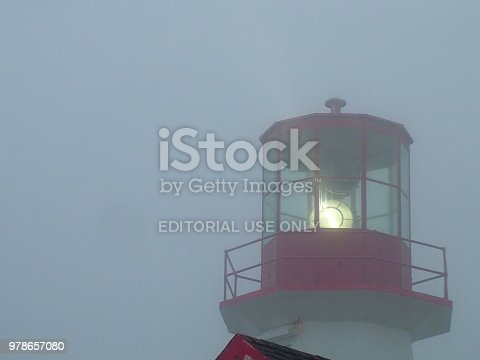 Quirpon Island, Newfoundland, Canada, June 26, 2011: The historic Quirpon Lighthouse in fog on Quirpon Island.