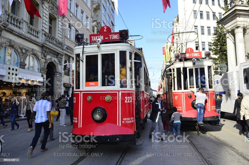The Historic Red Tram on Istiklal Street , one of the busiest streets...