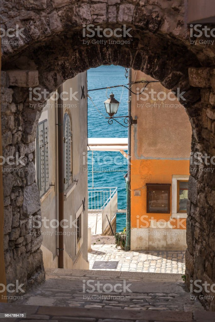 The historic street with underpass. Rovinj town on Adriatic sea, royalty-free stock photo