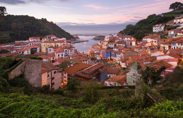 The historical fishing village of Cudillero at sunset. Asturias, Spain, Europe. stock photo