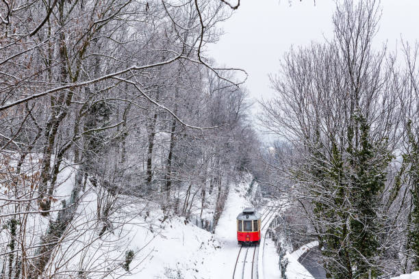 The historical Sassi- Superga ( Turin-Italy) rack tramway in winter time. stock photo