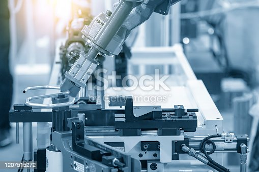 The hi-technology  material handing process by robotics system tube bending process. The hi-technology automotive parts manufacturing  process control by computer system.