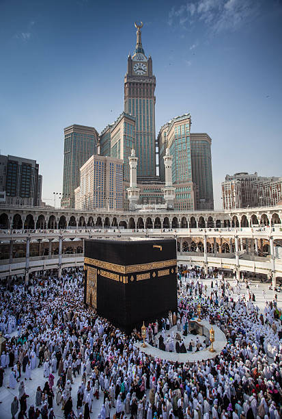 The Holly Kaaba Makkah, Saudi Arabia, March 2nd 2014: Located in  the middle of Al Masjid Al Haram, it is the most sacred place in islam and also the direction of praying for all muslim. circumambulation stock pictures, royalty-free photos & images