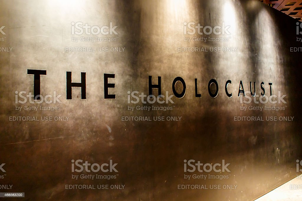 The Holocaust carved in a wall stock photo