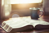 istock The holy bible and a cup of coffee on table 1213713700