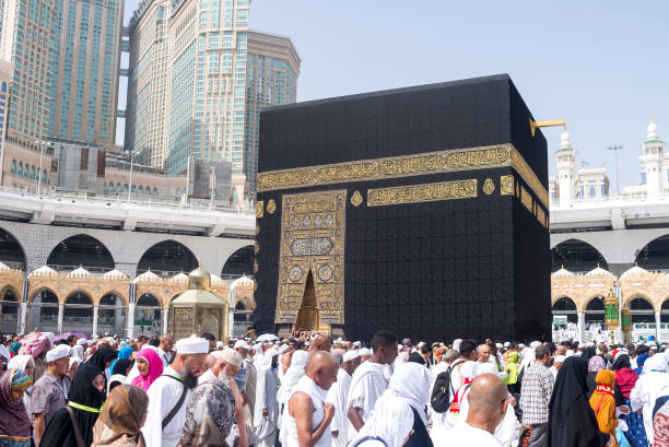 The Holy Kaaba Tawaf is a ritual during Umra or Hajj when pilgrims making seven circles around The Holy Kaaba in Masjid Al Haram umrah stock pictures, royalty-free photos & images